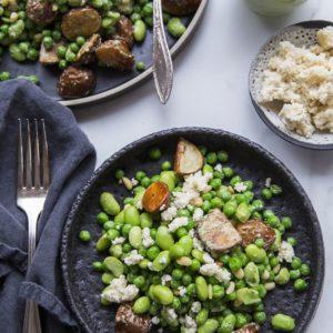 edamame and potato salad on bowl next to dish of almond ricotta, salad dressing and fork