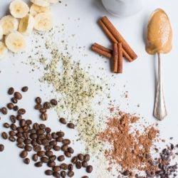 peanut butter on spoon with banana, cocoa and hemp hearts