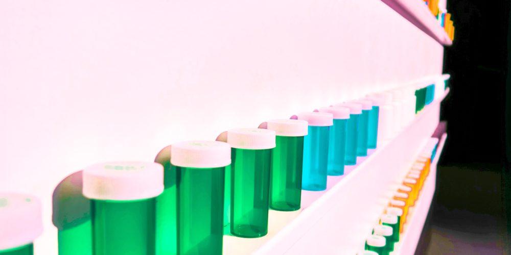 shelf of colourful probiotic bottles