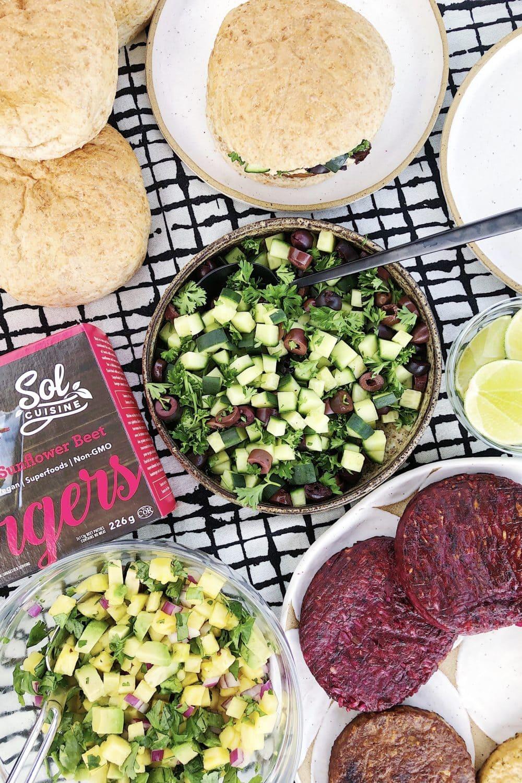 salads, buns, veggie burgers on plates