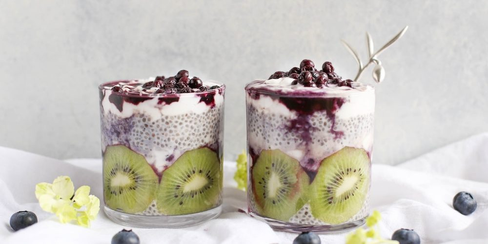 glasses of kiwi and chia seed pudding with blueberries