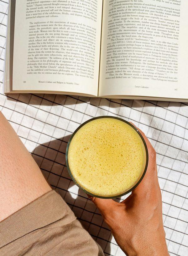 vegan orange julius drink with book