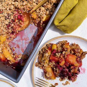 vegan peach blackberry crumble on white plate