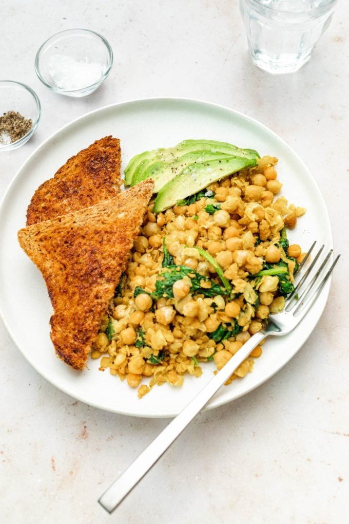 Close up of Registered Dietitian Desiree Nielsen's Chickpea Scramble with Toast and Avocado on Plate